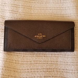 Coach Leather Wallet in black.